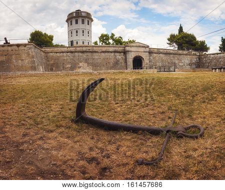 Big Rusty Anchor in front of Pula Fortress, Istria, Croatia