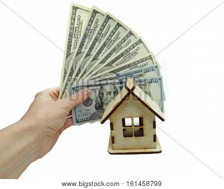 house model and dollar cash money in hand real estate concept