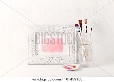 Hand drawn watercolor background in a picture frame