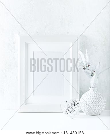 White image frame with a vase and Christmas decoration