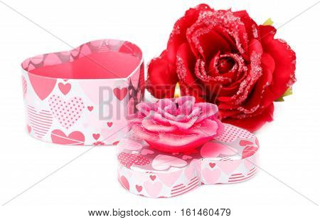Red rose candle and gift box isolated on white background.