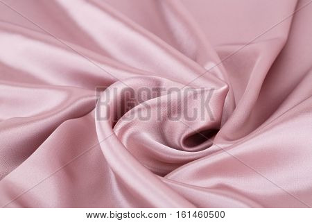 Pink silk fabric texture for background, close up picture.