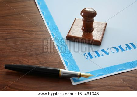Stamp, pen and certificate on notary public table