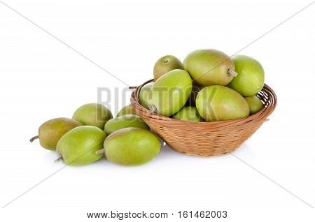 fresh green olive in bamboo basket on white background
