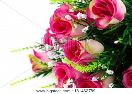 Pink fabric roses on white background, close up picture.