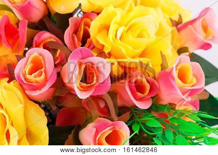 Colorful fabric roses horizontal close up picture.