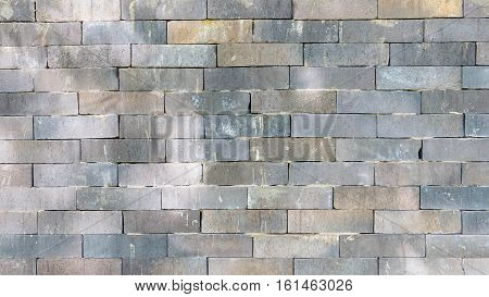 grey brickwall with sunlight for background and design