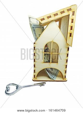 house model on dollar cash money inside real estate concept