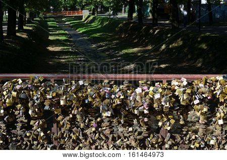 Padlocks On Bridge Of Love