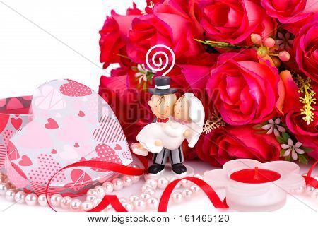 Red roses bride and fiance candle and gift box close up picture.