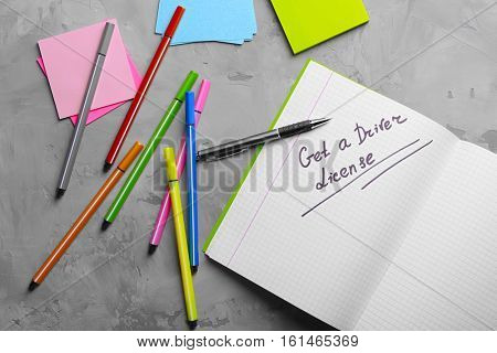 Notepad with text and stationery. Driver license concept