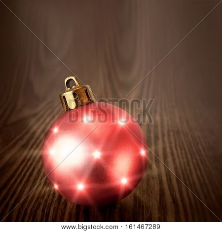 Christmas pink ball on a wooden background