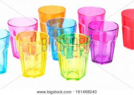 Colorful plastic glasses on white background, close up picture.