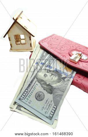 house model on dollar cash money in wallet real estate concept