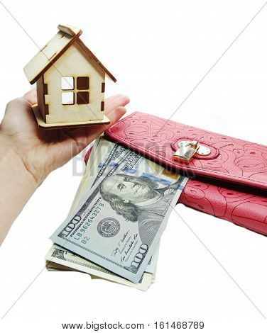 house model on hand dollars cash money in wallet real estate concept