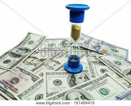 sand watch on dollar cash money background real estate concept