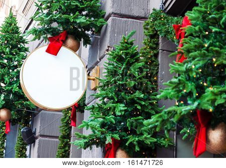 Blank outdoor signage mockup to add company logo decorated with Christmas decorations