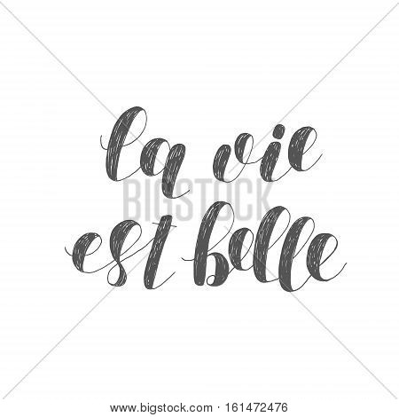 La vie est belle, life is beautiful in French. Brush hand lettering illustration. Inspiring quote. Motivating modern calligraphy. Can be used for posters, clothes, prints, home decor, cards and more.