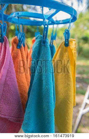 colorful Clothes hang on clothesline plastic, outdoor.