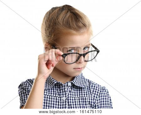Funny little girl with glasses on white background