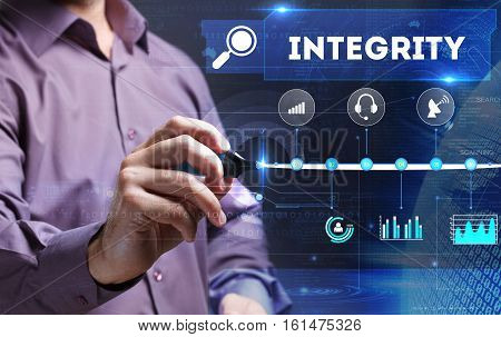 Technology, Internet, Business And Marketing. Young Business Person Sees The Word: Integrity