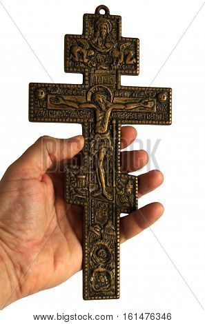 Human hands holding bronze Cross with crucified Jesus Christ