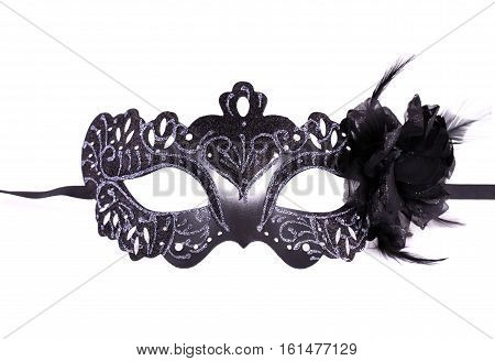 Carnival mask with feather isolated on white background.