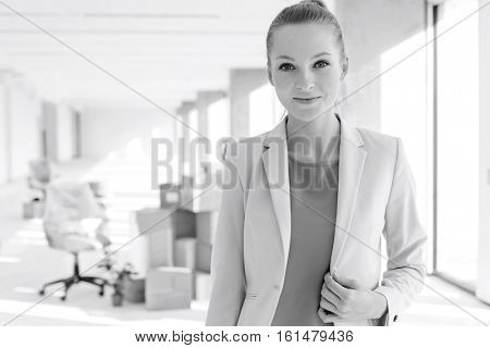 Portrait of beautiful young businesswoman in new office