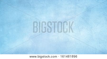 Abstract Grunge Decorative Light Blue Plaster Wall Background with Winter Pattern. Vintage Rough Stylized Texture Wide Screen With Copy Space for Design.
