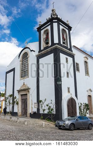 OBIDOS PORTUGAL - OCTOBER 15 2015: The church of Obidos in Portugal popular tourist destination because of its a well-preserved medieval architecture