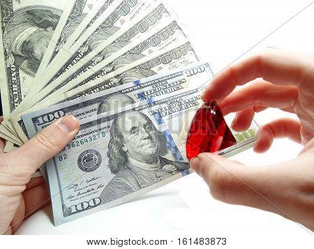ruby gem on dollar cash money background real estate concept