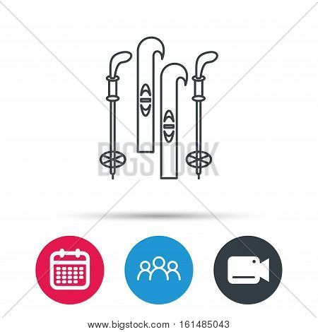 Skiing icon. Ski and sticks sign. Group of people, video cam and calendar icons. Vector