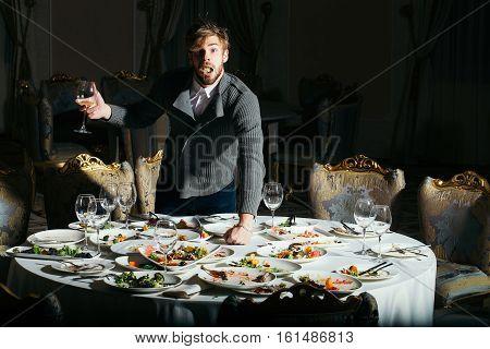 Surprised Man Eats After Banquet