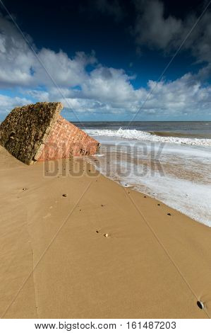 a brick Pillbox sinking into the sand at Covehithe Suffolk