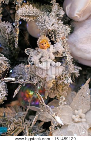 Moscow Russia - November 30 2016: Toy Snow Fairy hanging on the branch of Christmas tree in the Central Department Store GUM in Moscow