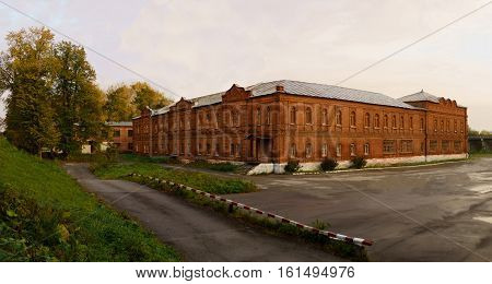 The external architecture of the old building of the 19th century. Russian stone architecture of the 19th century. Old red brick building.