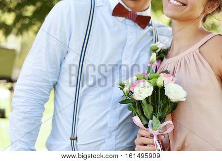 Bridesmaid and groomsman on wedding day