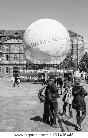 Pedestrians In Front Of Globe Pavillion France Candidacy For World Fair 2025