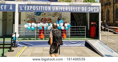 Man Walking Towar Pavillion Of France Candidacy For World Fair 2025