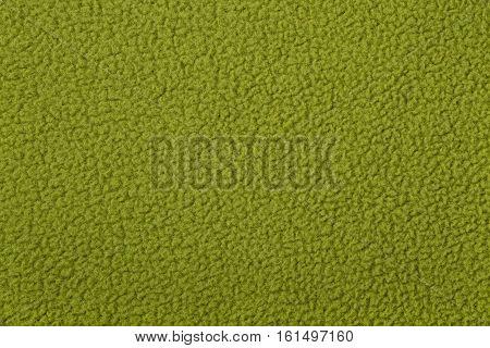 Green polar fleece as background texture close up