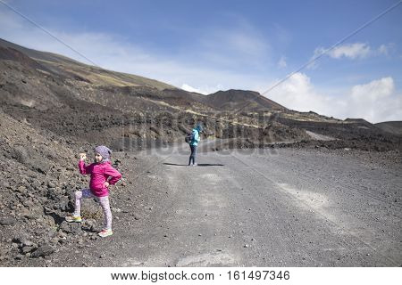 Girl posing during brake. etna hiking trip Sicily