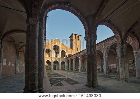 Exterior view of Basilica of Saint Ambrogio facade and porch