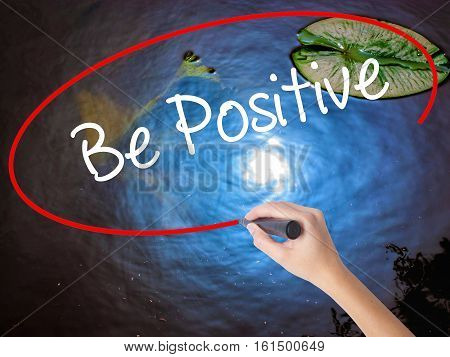 Woman Hand Writing Be Positive  With Marker Over Transparent Board