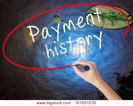 Woman Hand Writing Payment History With Marker Over Transparent Board
