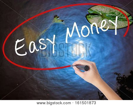 Woman Hand Writing Easy Money With Marker Over Transparent Board
