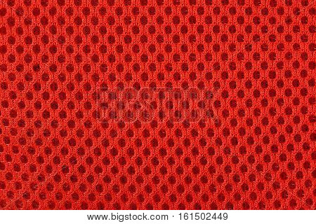 Orange nonwoven fabric as background texture close up