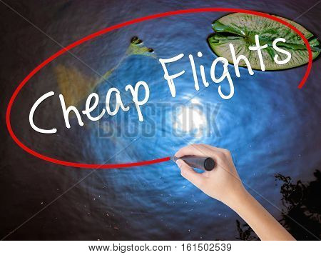 Woman Hand Writing Cheap Flights With Marker Over Transparent Board