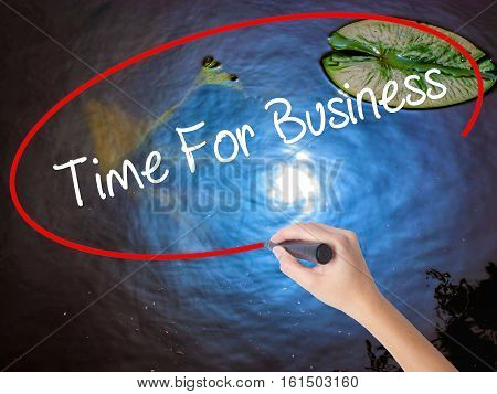 Woman Hand Writing  Time For Business  With Marker Over Transparent Board