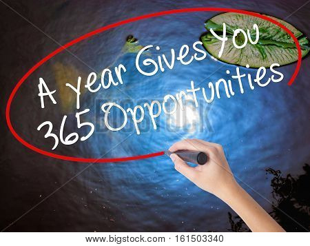 Woman Hand Writing A Year Gives You 365 Opportunities With Marker Over Transparent Board
