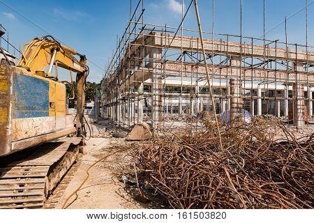 an excavator demolishing an old building horizontal
